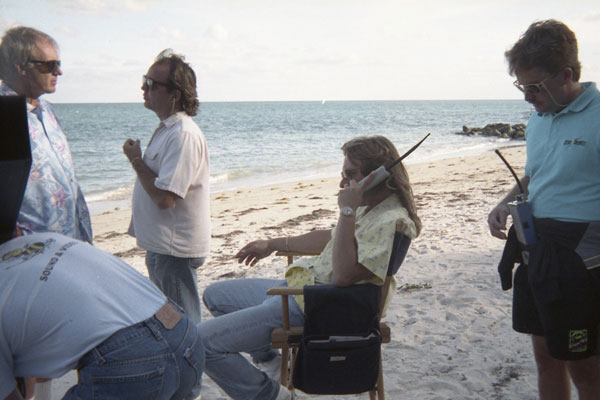 1991-The-100-Lives-of-Black-Jack-Savage-5-woman-on-phone-on-beachjpg
